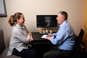 discussion with a back pain chiropractor